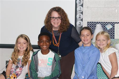 Ms. Foster with students